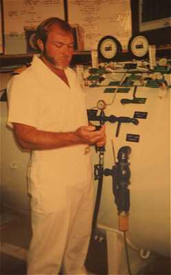 Capt. Bret Gilliam, a credentialed hyperbaric medical supervisor, operating recompression  chamber during trials for algorithm development for dive tables and computers. (1989)