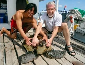 Raffle Winner Greg Holzer and turtle