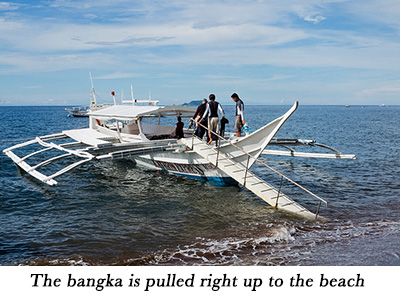 The bangka is pulled right up to the beach