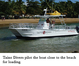 Taino Divers pilot the boat close to the beach for loading.